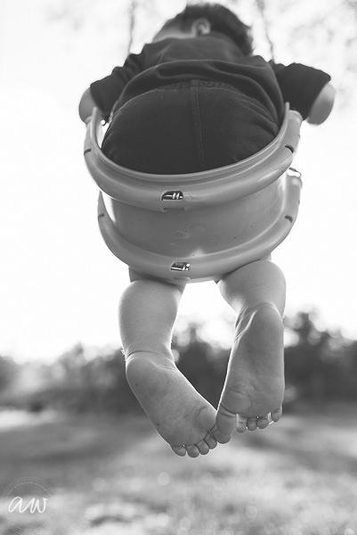 little boys feet on swing