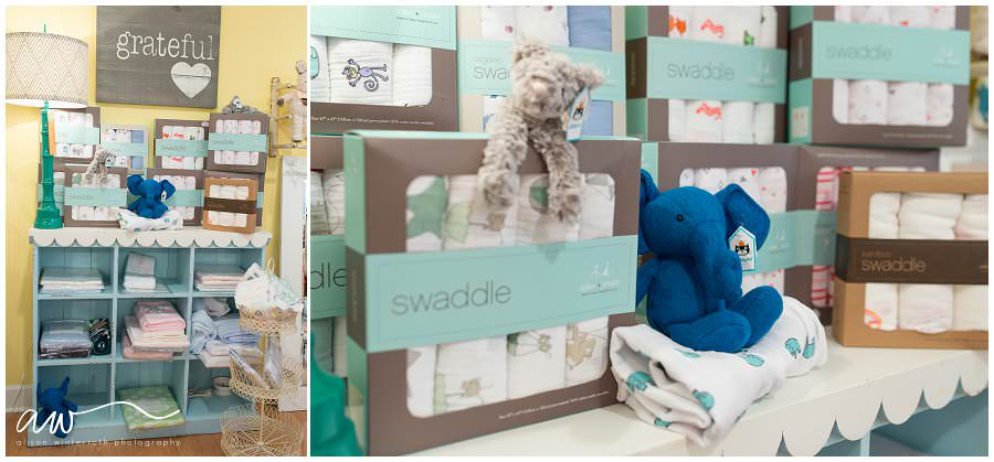 a bookcase with aden and anais swaddles at a baby boutique in south tampa.