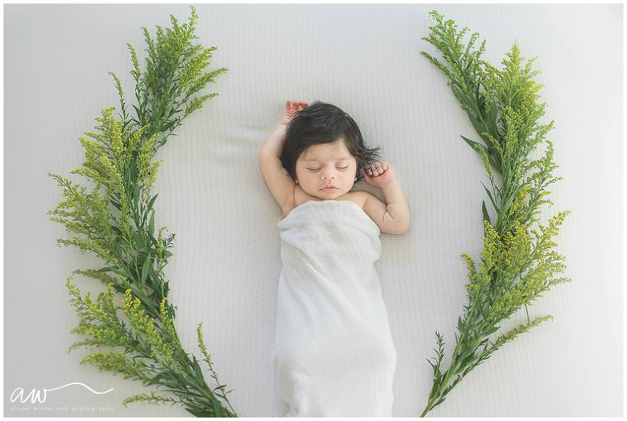 Fine art photograph of a newborn baby in flowers in Tampa Fl
