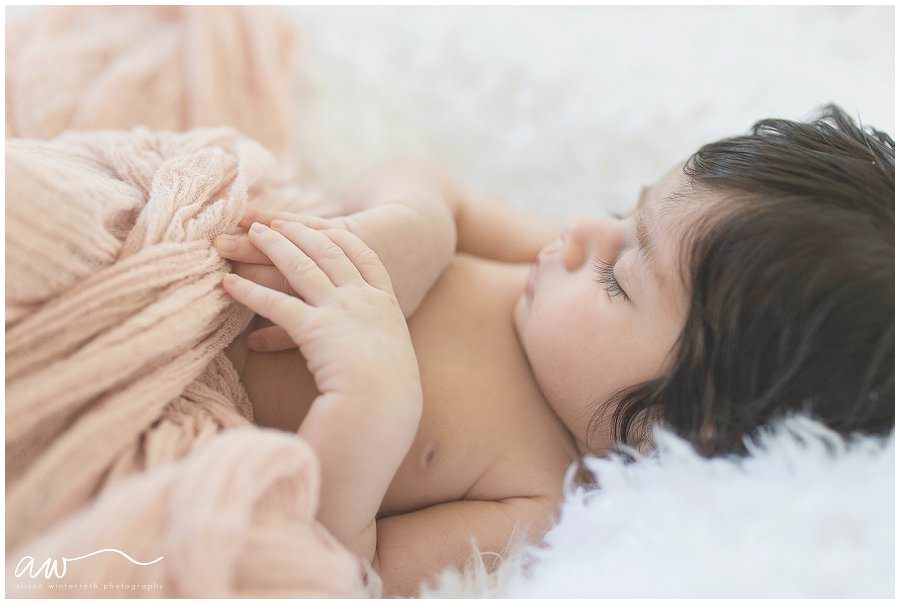 South Tampa newborn photography session with a baby on a white fer blanket.