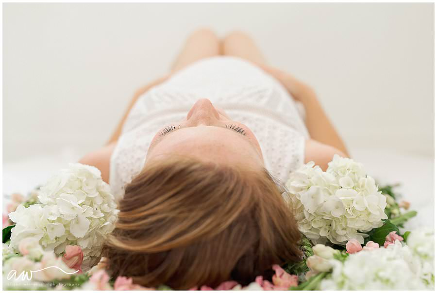 A maternity image with flowers around a mother's head.