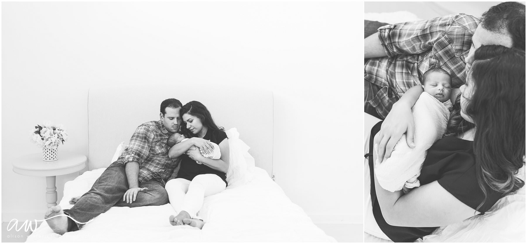 A gorgeous new family sits on a bed with their new baby {Florida's Newborn Photographer}