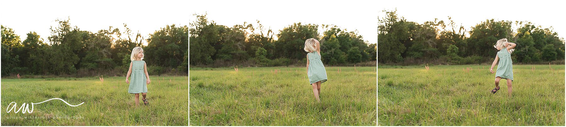 A young girl twirling in an open field