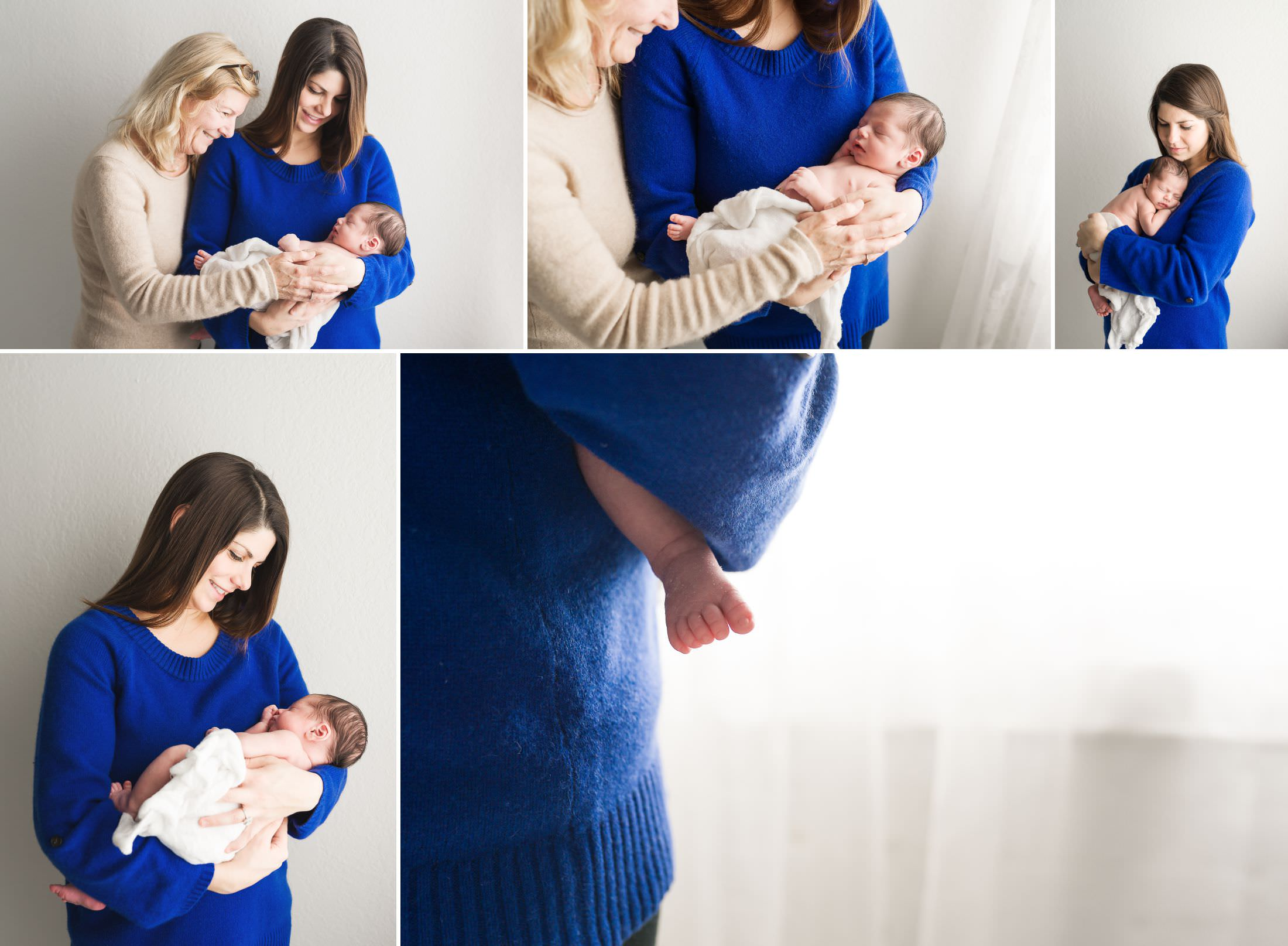 a mom and her mother hold a brand new baby boy in a natural light photography studio