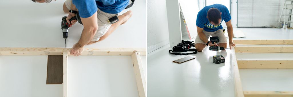 a man making a wood frame for a moving wall photography backdrop