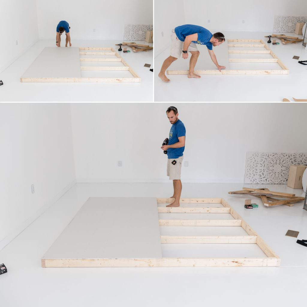 a man screwing a wood frame together for an 8x8 wall