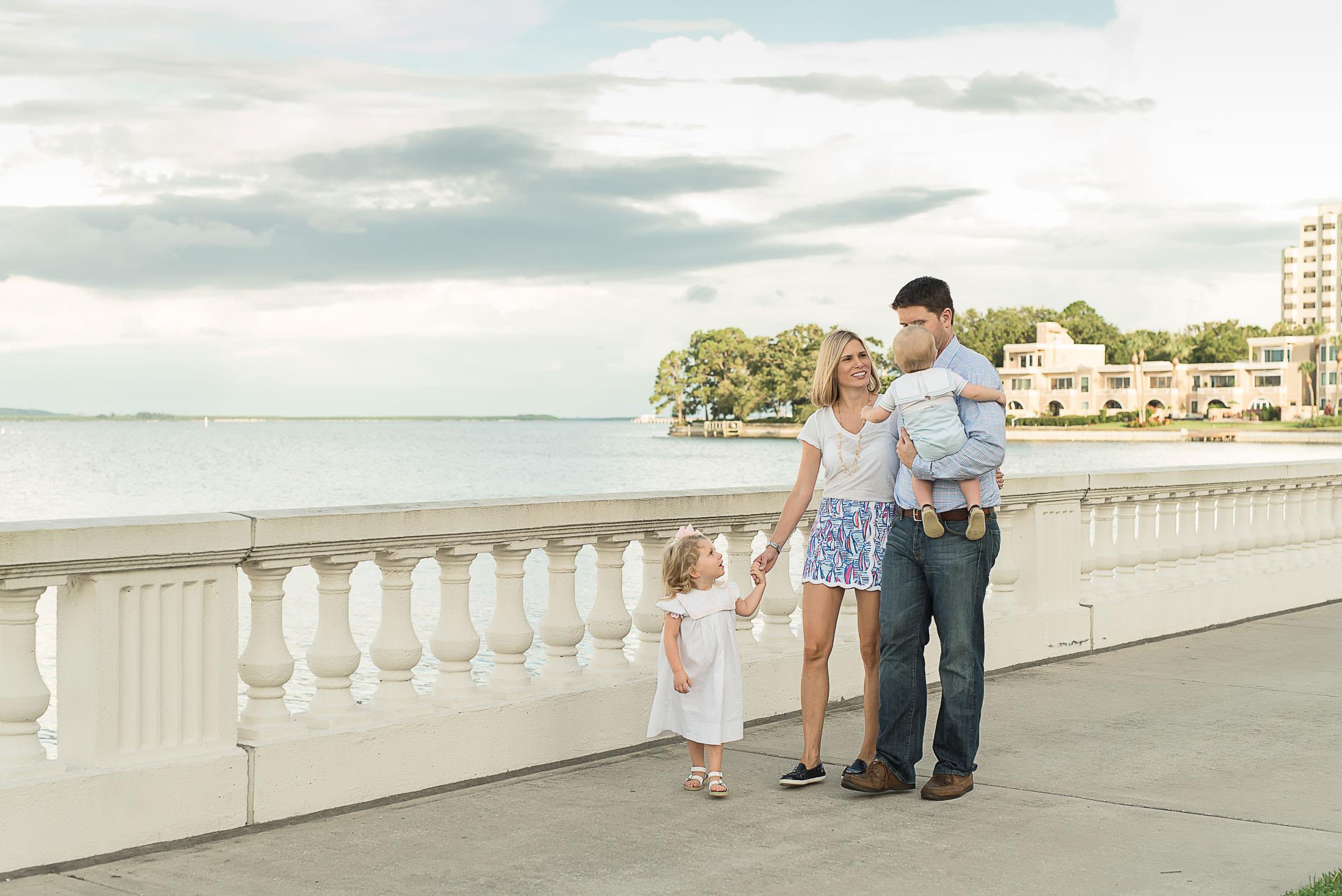 Family of four walking along bayshore blvd
