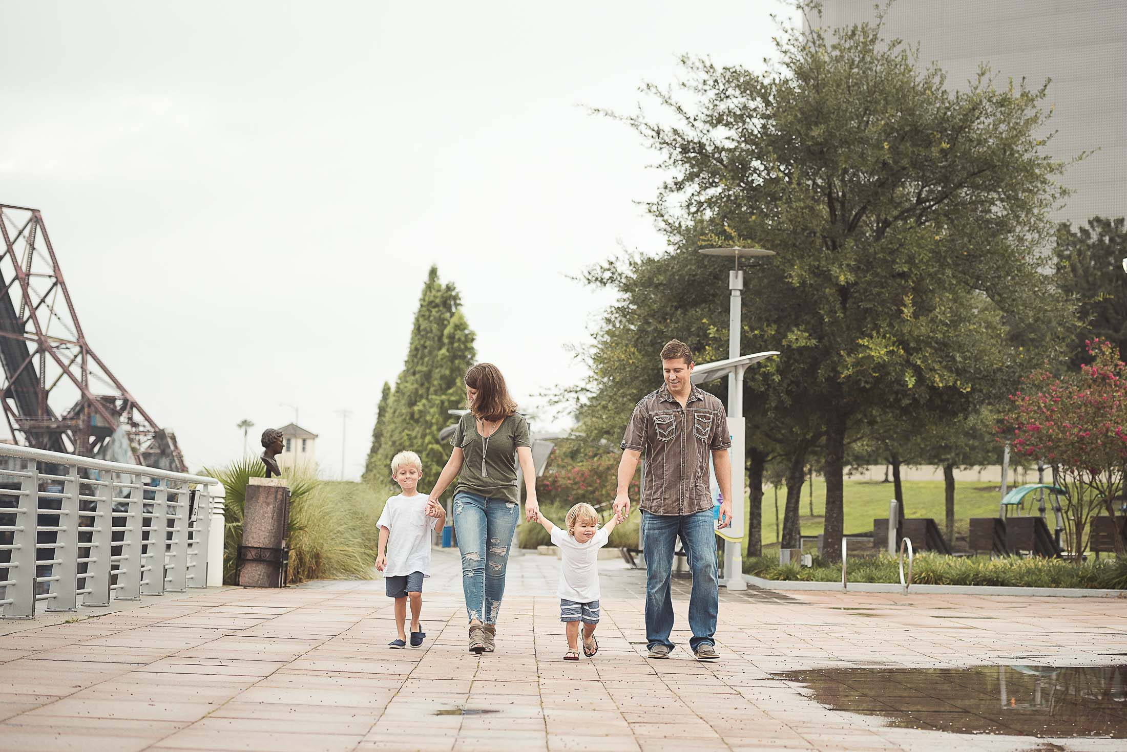 family of four on the Tampa Riverwalk holding hands