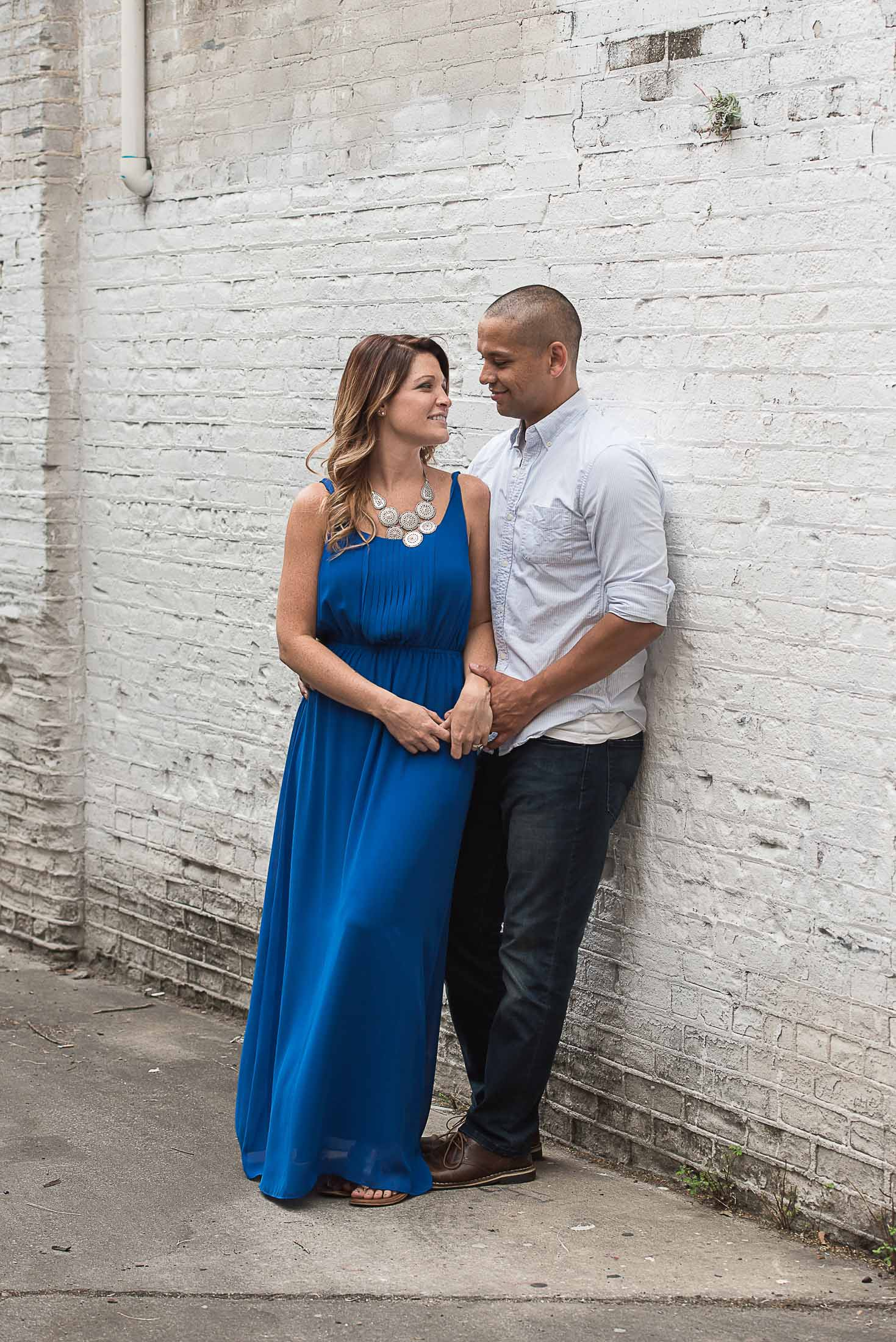 husband and wife in an alley in Ybor City